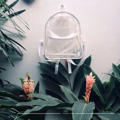 Grid pattern plastic backpack from White Wednesday