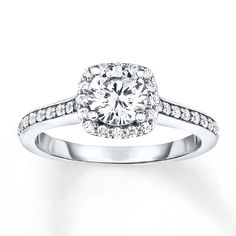 An exquisite round diamond outlined in smaller round diamonds is the captivating focal point of this engagement ring for her. More diamonds sparkle along the band, styled in white gold, for a total diamond weight of carat. Engagement Rings Channel Set, Engagement Ring For Her, Diamond Engagement Rings, Metal Jewelry, Gemstone Jewelry, Diamond Stone, White Gold Rings, Colored Diamonds, Ring Designs