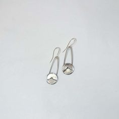 Silver Mountain Earrings, $50. Show your love for the mountains with these handcrafted silver earrings. Beautifully portrayed with a simple, rugged ridge line on a silver circle and attached to silver wire.  Made by a North Carolina artist.