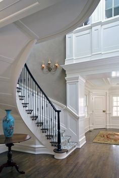 Love the stairway and mill-work in this spacious entryway. Foyer Staircase, Entry Foyer, Front Hallway, Beautiful Stairs, Beautiful Homes, Beautiful Curves, Foyers, Moulding And Millwork, Floating Stairs