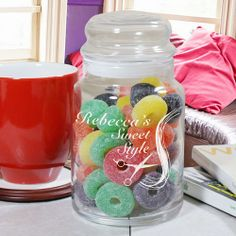"""Engraved Hair Stylist Glass Treat & Tip Jars. Provide your clients with sweets and little goodies with your own Personalized Hair Stylist Treat Jar. This creative, Personalized Treat Jar also makes a wonderful, personalized gift for your favorite Hair Salon Stylist as a thoughtful thank you gift. Your Engraved Hair Stylist Candy Jar measures 7""""H x 4""""W and holds 31 oz. Each glass jar comes with an air-tight glass lid. Contents displayed in glass jar not included."""
