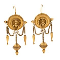 Antique 18 karat Gold Etruscian Revival Ear Pendants  A pair of English Etruscan Revival 18 karat gold ear pendants. The earrings are in a shield motif with woven chain festooned from a centered ring to the torpedo shaped drops. The center hanging drop is a disk girdled with wire in the archaeological revival style.  Circa: 1870's
