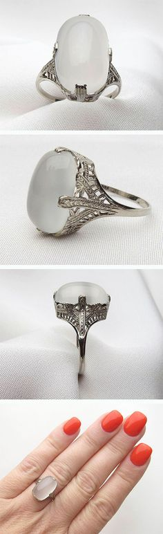 Gorgeous 14KT white gold filigree ring with 6.35 carat elongated Oval Cabochon Cut Cat's Eye Moonstone.