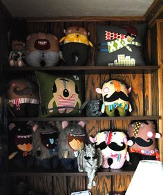 adorable cushions, plushies. Monsters and mustaches...two of my faves!