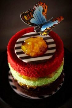 B's Cakery This signature Madame Butterfly cake is adorned with a hand-painted sugar butterfly, Ms. Instead of frosting, chocolate, pistachio and red velvet cake is layered with fresh fruit filling. Pretty Cakes, Beautiful Cakes, Amazing Cakes, Chiffon Cake, Mini Cakes, Cupcake Cakes, Butterfly Cakes, Madame Butterfly, Butterflies