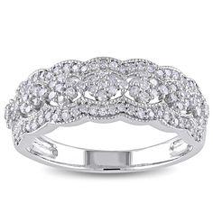 <li>Round white diamond ring</li> <li>10-karat white gold jewelry</li> <li><a href='http://www.overstock.com/downloads/pdf/2010_RingSizing.pdf'><span class='links'>Click here for ring sizing guide</span></a></li>
