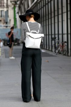 We love this Berlin style look.  Perfectly put together in all black and white with a tomboy touch in wide leg pants.
