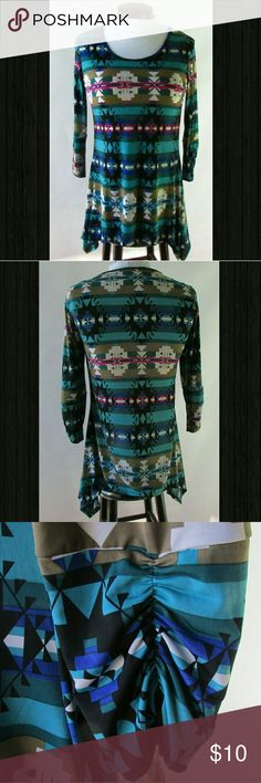 """Handkerchief Hem Tunic NWOT Never Worn! Blues and greens dance with white and black geometric patterns to make this gorgeous knit tunic amazing!  A wee bit of fushia in the mix brings even more fun to the party! 3/4 sleeves have ruched detail and handkerchief hem compliments the hips. Fabric has a light sheen to it, is soft and a bit stretchy.  Measurements laying flat- Bust 43"""" Waist 42"""",  Hip I'm going to call 52"""", due to elongated handkerchief hem, Length 31"""". Model photo from Zulily…"""