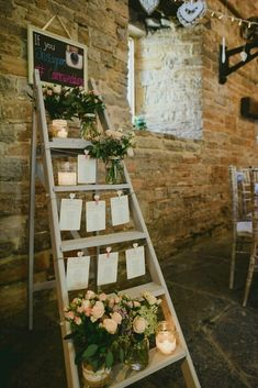 Step ladder wedding table plan with candles, glass jars filled with flowers and strung up stationery - Image by Sam Gibson - Bride wears lace wedding dress at a rustic wedding in Almonry Barn Somerset. Bridesmaids & Groomsmen outfits from Debenhams Wedding Seating Display, Seating Plan Wedding, Seating Plans, Wedding Table Plans, Wedding Entry Table, Wedding Table Assignments, Wedding Table Names, Reception Seating, Reception Ideas