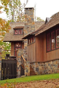 This beautiful rustic lake house retreat features a wood slat exterior and red accents by Jeffrey Dungan Architects, in Birmingham, Alabama. Rustic Lake Houses, Rustic Houses Exterior, Cottage Exterior, Exterior House Colors, Exterior Design, Rustic Cabins, Wood Siding, Exterior Siding, Exterior Paint