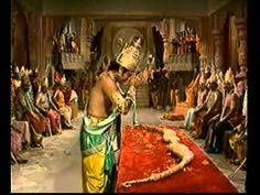 Shri Rama breaking Shiva's divine bow in assemblage of kings invited by Janaka for Sita-Swayamvara.
