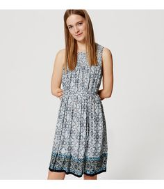 """Just when we thought this floral dress could get any sweeter, a smocked yoke highlights its femme appeal. Round neck. Sleeveless. Belt loops. Removable waist tie. Shirred beneath front and back yoke. Lined. 20"""" from natural waist."""