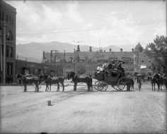 Stagecoach on Pikes Peak Avenue with the Antlers Hotel in the background.