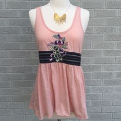 Free People Embellished Tank Top Adorable! Free People Embellished Tank with floral appliqué! So comfy too! Size Medium. Previously loved, has small stain on the back & piling, please see third photo. Priced accordingly. Free People Tops Tank Tops