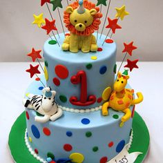 Each animal on this two tier cake is dressed in a party hat to celebrate Zachary's 1st Birthday. The cake was inspired by our Jungle cake and includes a gi