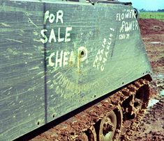 """""""For Sale Cheap"""" reads the side of a US Army Cavalry Armored Personnel Carrier. """"Try again Charlie!"""" is also written beside a hole in the side of the vehicle. And in the upper corner, """"Flower Power"""" which is written over the stamped """"US. Vietnam History, Vietnam War Photos, Vietnam Vets, North Vietnam, Military Post, Military Humor, Military Photos, Military Service, Good Morning Vietnam"""
