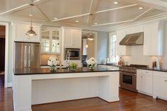 white kitchen black granite