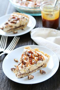 Twix Ice Cream Pie Recipe on twopeasandtheirpod.com Shortbread cookie crust with a layer of chocolate, vanilla ice cream, chopped Twix candy bars, and salted caramel sauce. The BEST summer dessert!