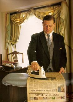 English butlers iron newspapers? Yes. To dry the still wet ink so Lord Grantham doesn't get ink on his fingers and clothes.