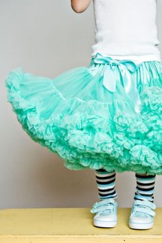 big poofy turquoise pettiskirt and sneakers! I wish I could pull of style like this, but it would probably just look skanky. Or mental.