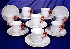 Ginori Demitasse Set. Italian Make that I'm not familiar with although the gorgeous red twist handles have me mesmerized!!