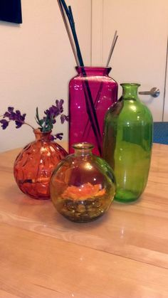 Colored glass vases on kitchen table.