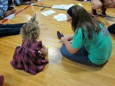 Marist crafting with local children during their RIF event! #KKG #KKG1870