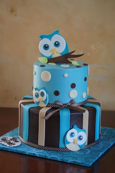 Blue owl themed baby shower cake