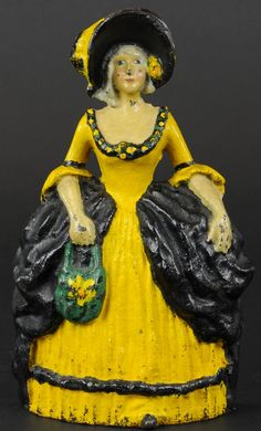 Bright colored paint variation, charming depiction of elegantly dressed woman in gold dress w/black bustle, flared ha. on May 2013 Diy Doorstop, Woman In Gold, Door Stopper, Living Dolls, Iron Work, Door Knockers, Metal Casting, Mellow Yellow, Green And Orange