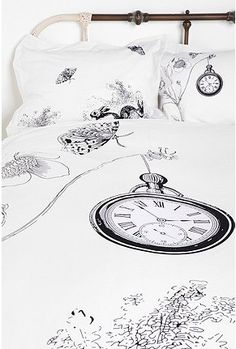 I LOVE this bedding. It reminds me of Alice in Wonderland.