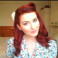 One victory roll + side swept. My hair is going to be a super short version of this for homecoming today. :)