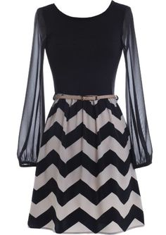 Chevron Ovation Dress: Features a lined noir bodice framed by sheer chiffon sleeves, flattering rear scoop design for subtle exposure, removable taupe skinny belt, and a chic chevron-printed skirt to finish.