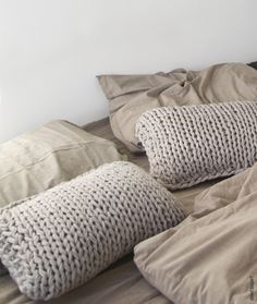 Soft pillows - am in the process of making similar ones now. Chunky yarn/big needles are the best!