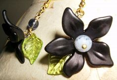 hanging lotus earrings on tophatter by Uniqueeuphoria