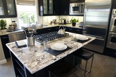 This kitchen is a tad smaller than most in this gallery and it's distinguished with it's very dark color scheme.