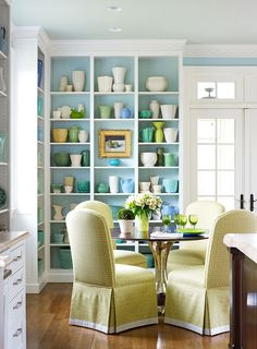 """Benjamin Moore paint (walls, """"Harbor Haze"""" #2136-60; ceiling paint """"Hollingsworth Gree #HC-141).  Love the fresh blue and green color scheme with the different variations in the bookshelves."""