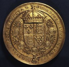 """This is the reverse side of the seal of Henry, which shows the arms of England and France quarterly surrounded by the collar of the Order of the Garter. The Latin motto surrounding it reads: """"All things are joined by order and stand firm by treaty"""". In honour of their renewed friendship both Kings were admitted to each others' orders of chivalry - the Order of St. Michael (French) and the Order of Garter (English)."""