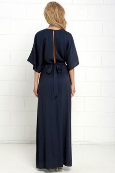 Sophisticated with a relaxed touch, the Modern Form Navy Blue Maxi Dress is all we've been pining for! Lightweight woven bodice has short kimono sleeves, a V neckline, darted bust, and full-length back slit below a button closure. Maxi skirt boasts a high side slit. Waist sash. Hidden back zipper with clasp.