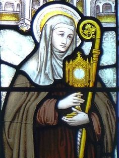 detail of a stained glass window of Saint Clare of Assisi; date unknown, artist unknown; church of Saint Stephen, South Kensington, London, England; photographed on 22 December 2014 by Oxfordian Kissuth; swiped from Wikimedia Commons