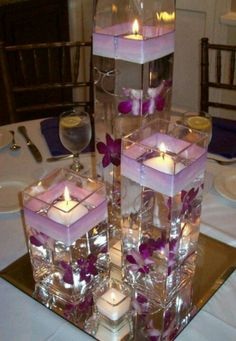 Wodnerful DIY Unique Floating Candle Centerpiece With Flower Wedding Flowers, Beautiful And Inexpensive Purple Wedding Centerpieces: inexpensive wedding flowers. wedding flowers Wodnerful DIY Unique Floating Candle Centerpiece With Flower Purple Wedding Centerpieces, Floating Candle Centerpieces, Diy Centerpieces, Wedding Decorations, Table Decorations, Purple Centerpiece, Quince Decorations, Homemade Wedding Centerpieces, Wedding Bouquets