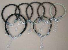 Braided horsehair bracelets of many different colors of hair, with sterling silver endcaps but no center bead.