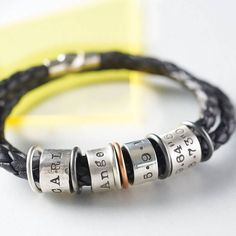 Men's Leather And Silver Story Bracelet from notonthehighstreet.com what a lvly idea, my partner has dog tags with our premature babies weight and head size ect on. So I think as an addition this would be lvly with some personal memories on the beads for him to remember. So getting one.