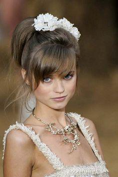 Light ash brown hair with cute bangs.