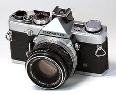 Just got a new lens for my very first camera (Olympus OM-1... which I still use)... It's actually the same lens pictured here: 50mm f/1.8 Zuiko... le sigh.