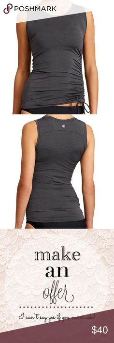 Athleta Gray Heather Scrunch Rashguard Tank Top Athleta 'Heather' Scrunch Rashguard in black. Size xsmall.  Adjustable side cinching for a custom look and coverage Takes you from surf to sand Nylon/Lycra® Spandex LYCRA® XTRA LIFE™ SPANDEX. Ultra-resilient fabric snaps back like a pro and lasts 5-10x longer Breathable, sleek, stretchy fabric feels super luxe Rated UPF 50+ (Excellent Protection) Machine wash and line dry. Athleta Tops Tank Tops