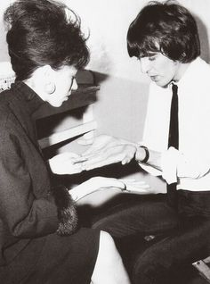 "the-cosmic-empire: ""These two photos are from George's Twitter feed earlier this week. George having his palms read by palm reader, Eva Petulengro in Brighton, on the 25th October 1964. Look how..."
