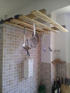 The simplest way to use a pallet... Some screw hook and held in place with clamps.   #Kitchen, #PalletHanger, #RepurposedPallet