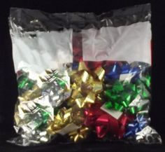 Berwick Peel 'n Stick Gift Bows are a great way to accent any wrapped gift or gift bag, and are easy to use! Simply peel the paper from the adhesive pad on the back of the bow and apply! This 32 count bow bag contains bows of assorted sizes and colors, and is great for both holiday and year 'round decorating. Christmas Tree Bows, Xmas Ornaments, Xmas Tree, Bow Bag, Gift Bows, Xmas Decorations, Adhesive, Count, Gift Wrapping