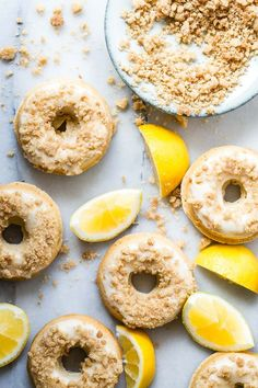 Fresh tasting baked lemon donuts, topped with a sweet lemon zest icing and buttery crumble chunks. These are so easy  to make and the flavor is wow!!