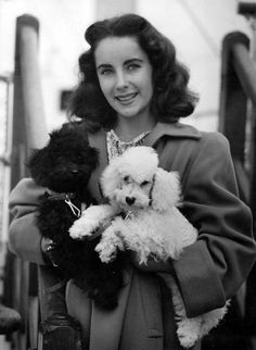 A young Elizabeth Taylor holding two cuties